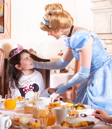 Cinderella visiting a guest at breakfast