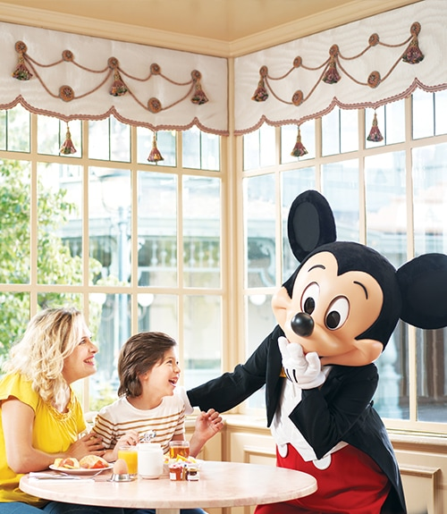Mickey Mouse at breakfast with a family