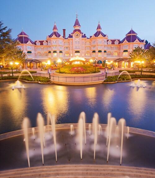 Disneyland® Paris Hotel illuminated at dusk