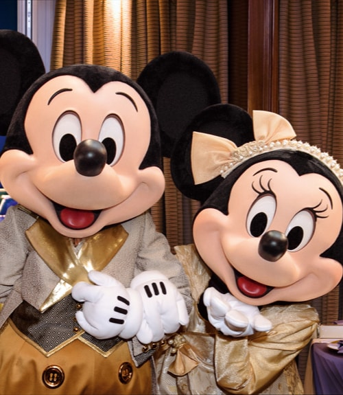 Mickey Mouse and Minnie Mouse in seasonal costumes
