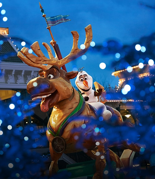Olaf riding Sven at the a parade