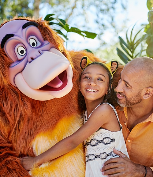 King Louie posing with a family