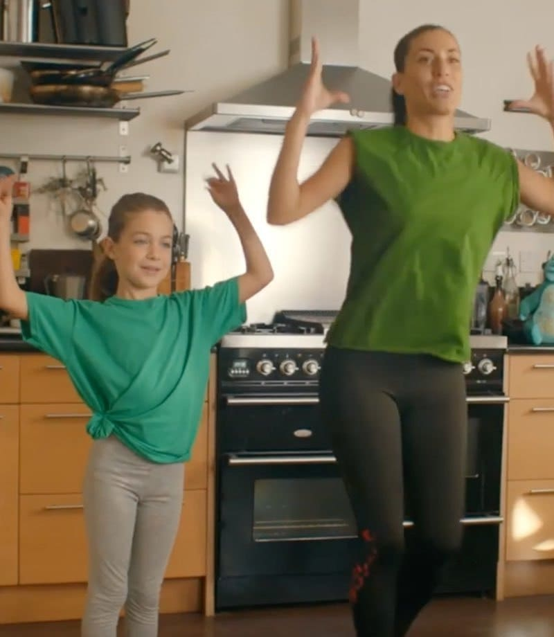 A mother and daughter exercising