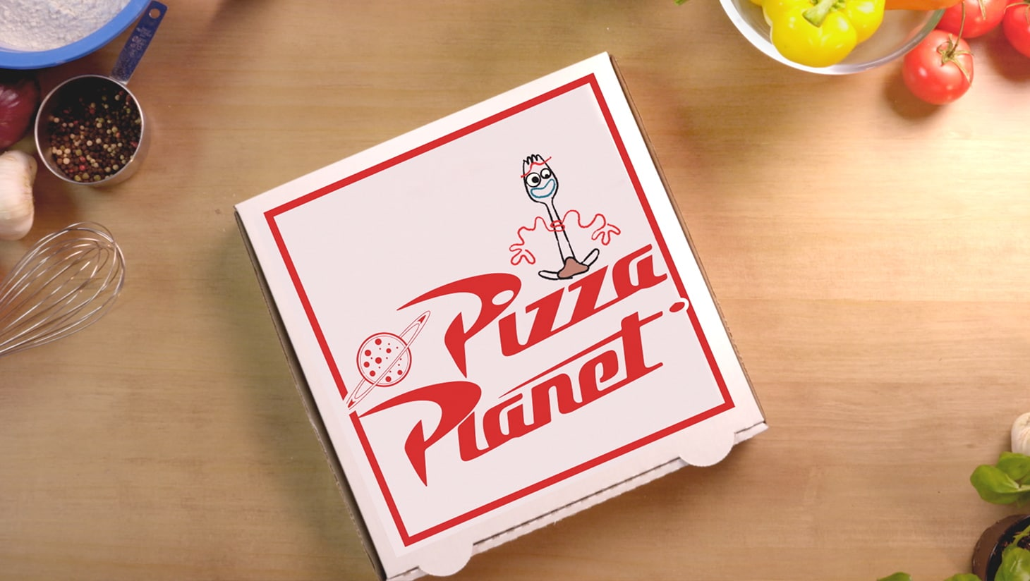 A Planet Pizza box with a drawing of Forky on it