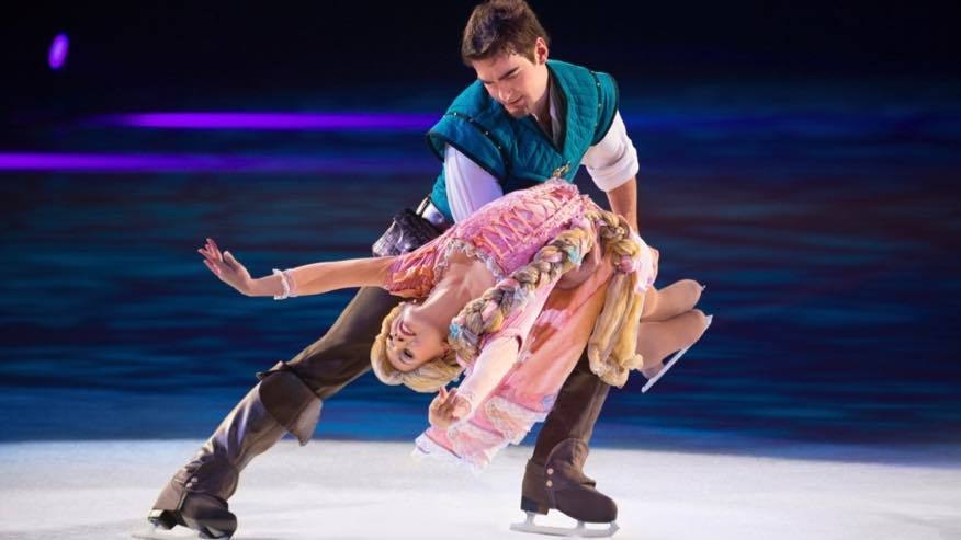 Flynn Rider holding Rapunzel in his arms whilst skating on ice