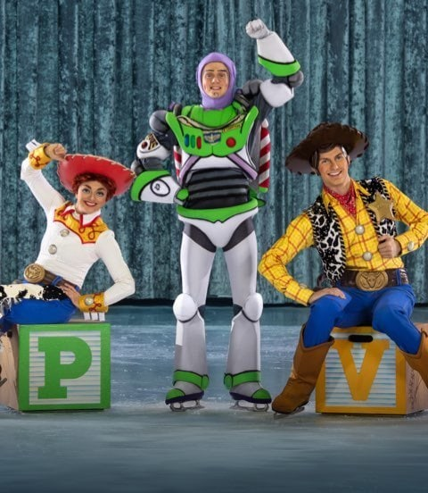 Jessie and Woody sat on large alphabet blocks with Buzz stood in between them on ice