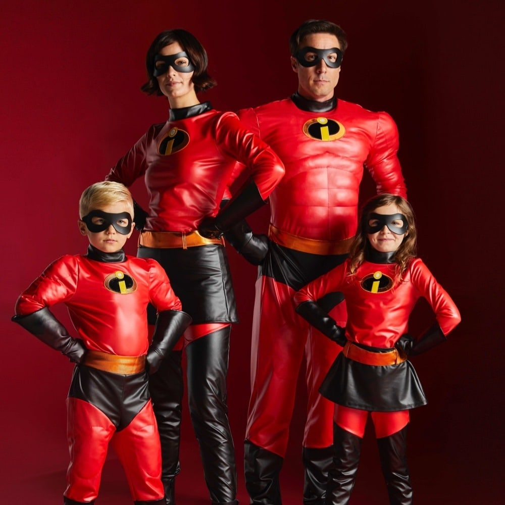 Family of two adults and two kids all wearing the Incredibles 2 Costumes