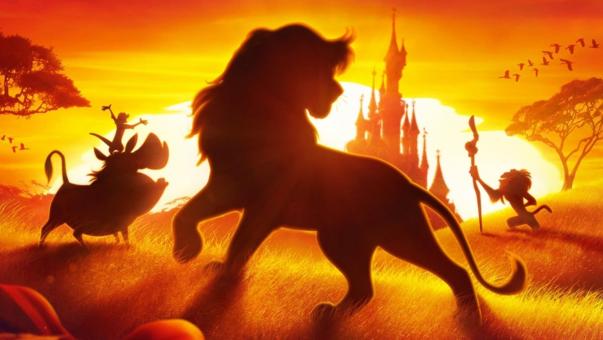 The Lion King characters in silhouette against a sunset in front of Sleeping Beauty's castle
