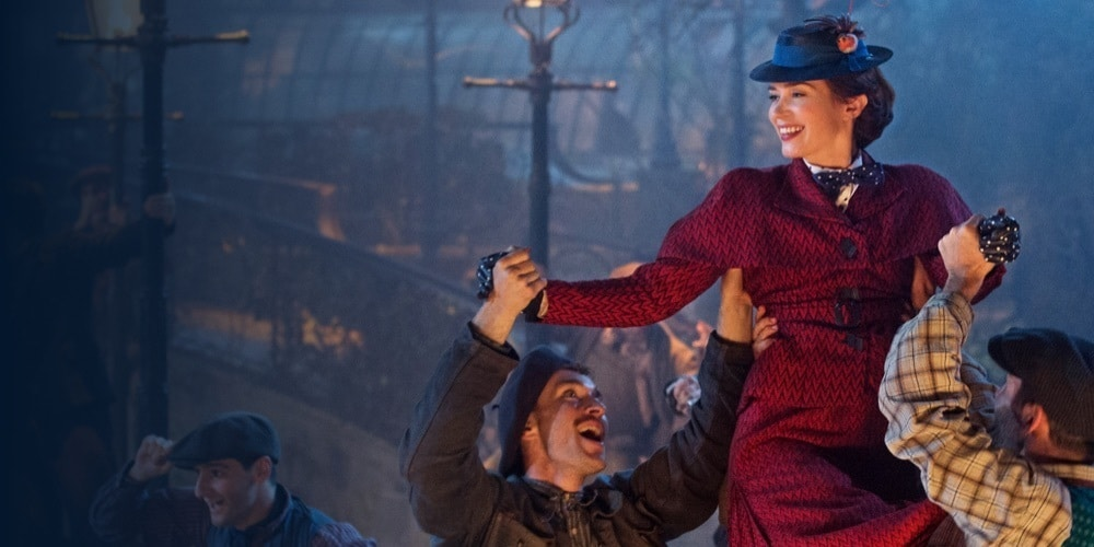 Mary Poppins being held up by two men during a dance scene