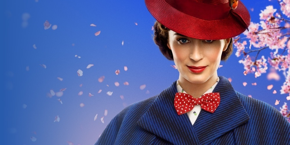 Close-up of Mary Poppins wearing a blue cape coat, red hat and polka dot bow tie