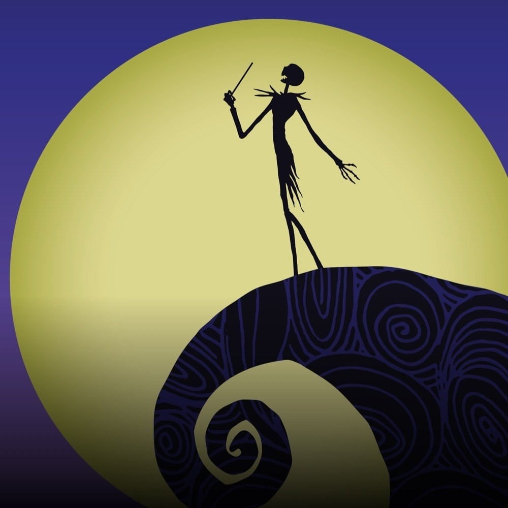 A silhouette of Jack Skellington conducting on the edge of a cliff with a giant moon and night sky in the background