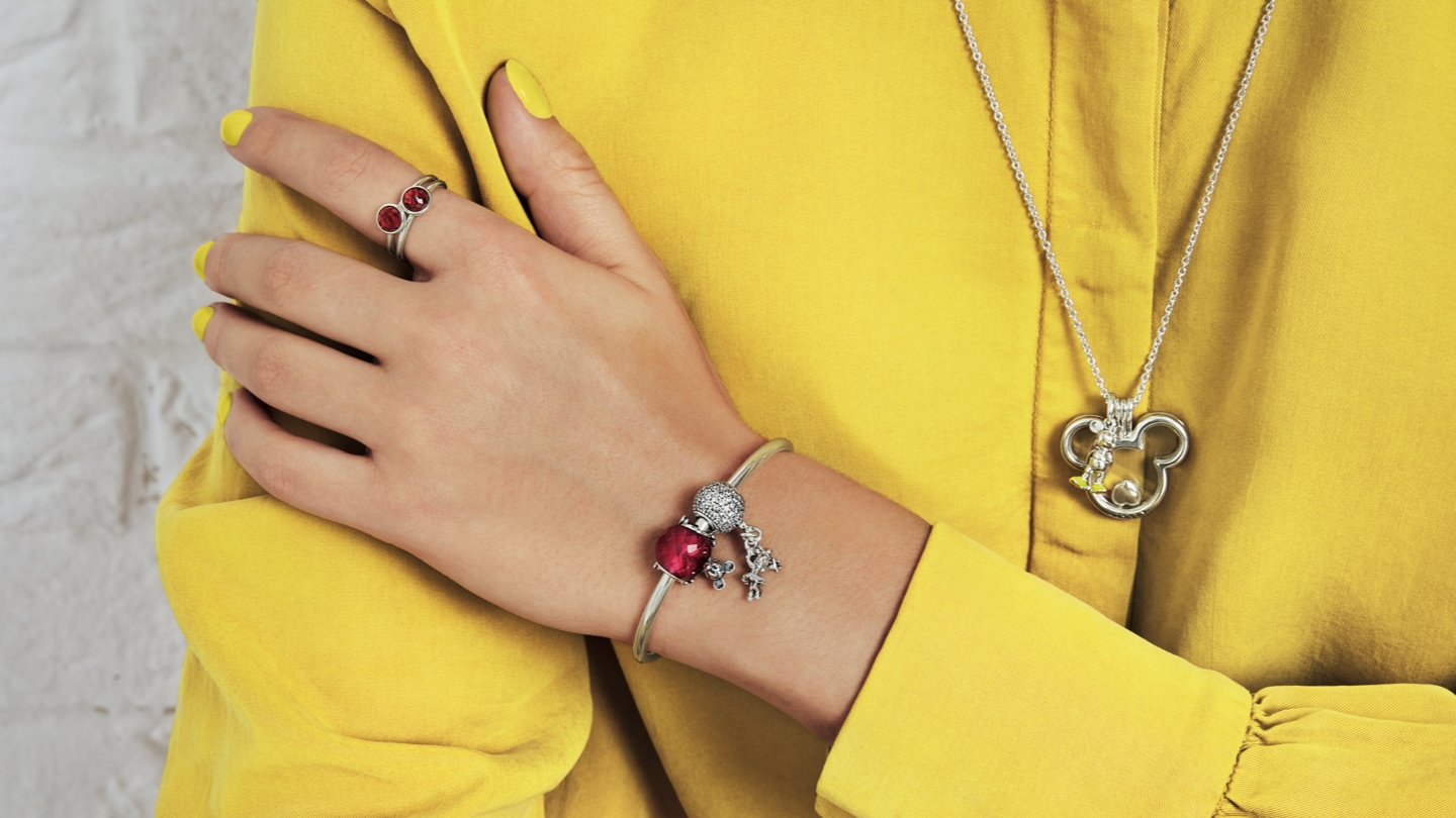 Close-up shot of hand model showcasing Disney Pandora jewellery