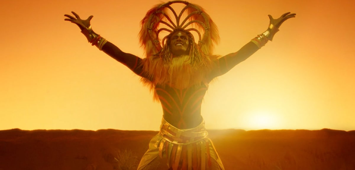 A cast member in a Lion King outfit