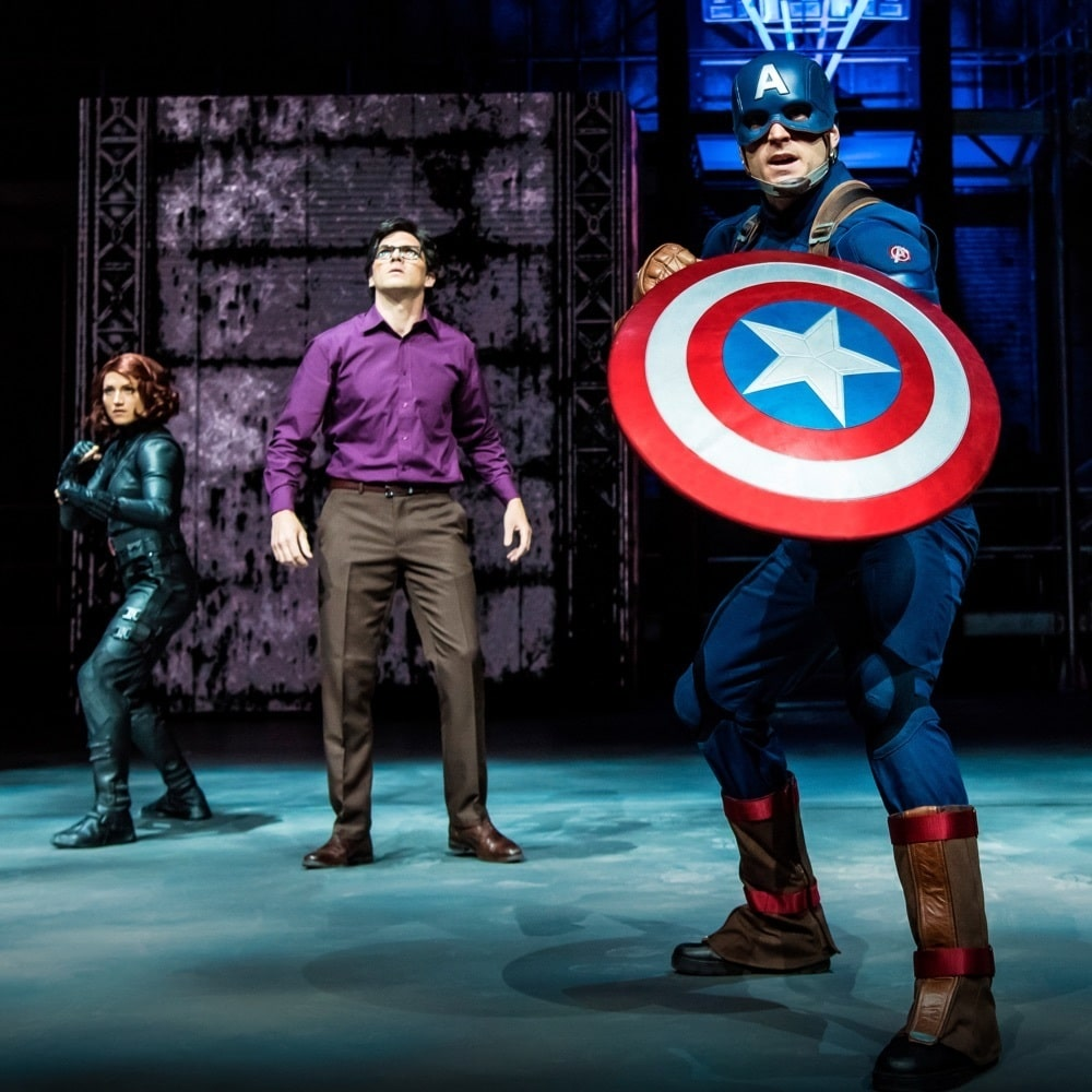Captain America, Bruce Banner and Black Widow on stage performing at Marvel Season of Super Heroes