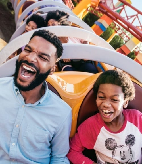 Young boy and dad on SlinkyDog Dash ride at Walt Disney World