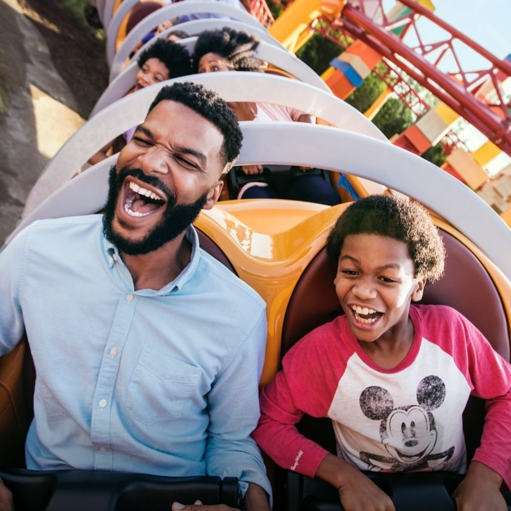 Man and child on the Slinky Dog rollercoaster