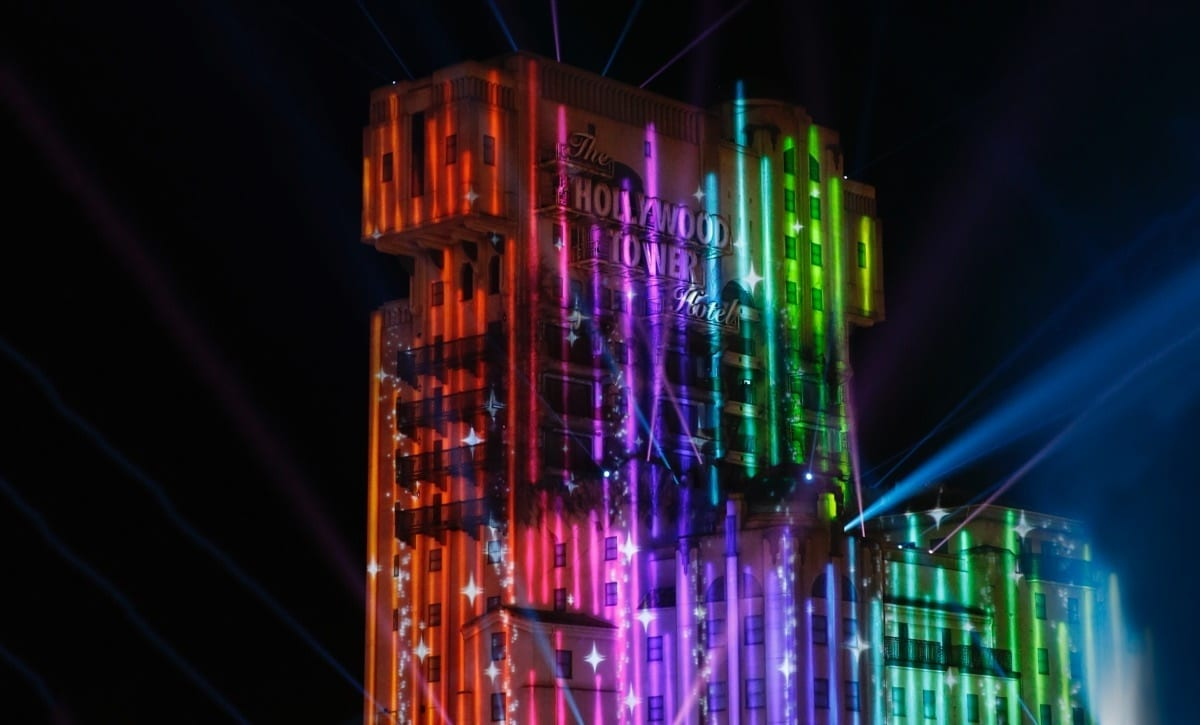 The Tower Of Terror attraction at Disneyland Paris with a rainbow flag projected on it