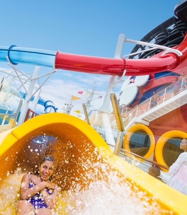 Women riding on the Aquaduck water slide aboard a Disney Cruise line.