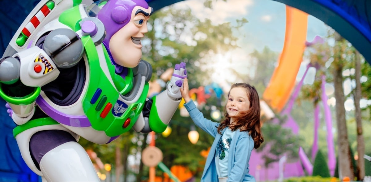 Buzz highfiving young girl