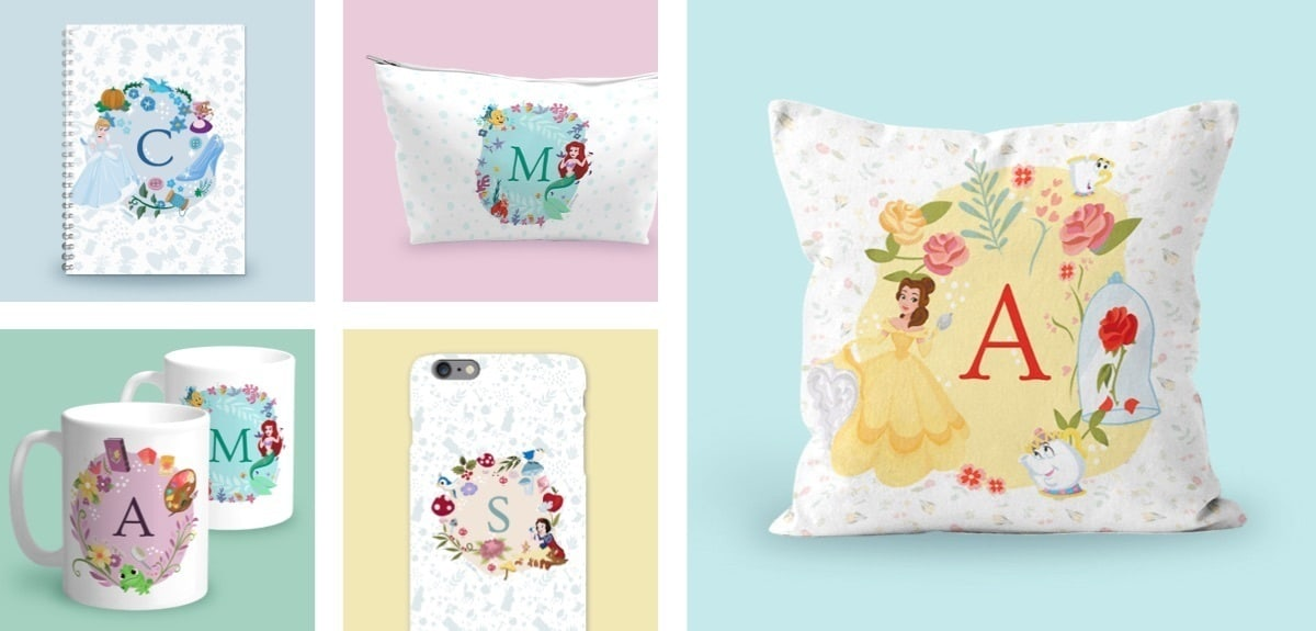 Belle inspired cushion with an 'A', Cinderella inspired notebook with a 'C', Mugs with Ariel and an 'M' and Rapunzel with a 'A', Snow White inspired phone case with an 'S'