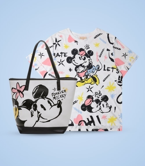 White T-Shirt with Mickey and Minnie hugging, pastel coloured candles and the text: 'Let's Celebrate' and 'Forever Mickey', a white bag with Minnie kissing Mickey