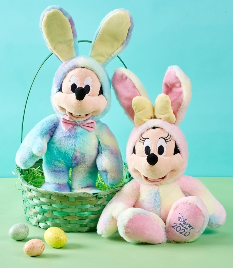 Mickey and Minnie soft toys dressed in tie-dye print bunny costumes