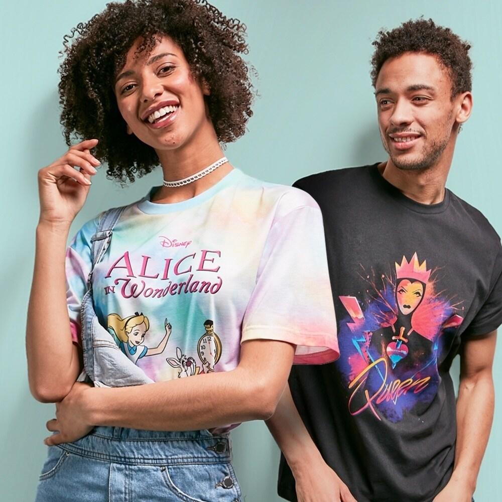 Woman wearing an Alice inspired t-shirt, man wearing an Evil Queen inspired t-shirt.