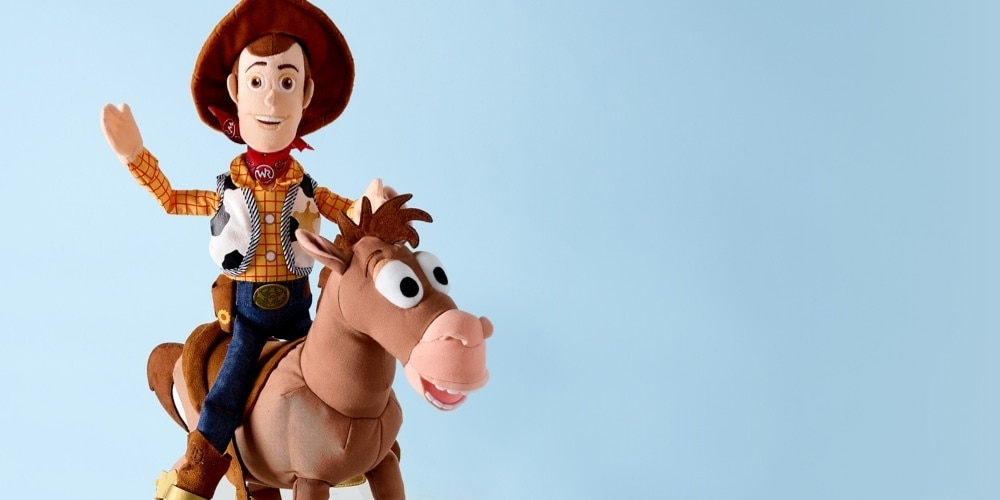 Woody inspired soft toy riding a Bullseye inspired soft toy.