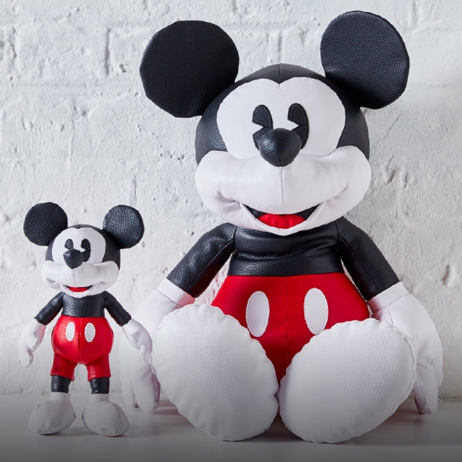 Large and small Mickey Mouse plush