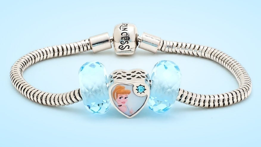Cinderella inspired charm on a silver bracelet.