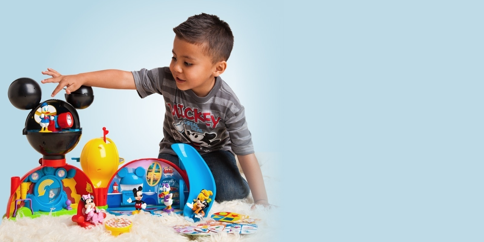 Toddler playing with Mickey Mouse Clubhouse playset