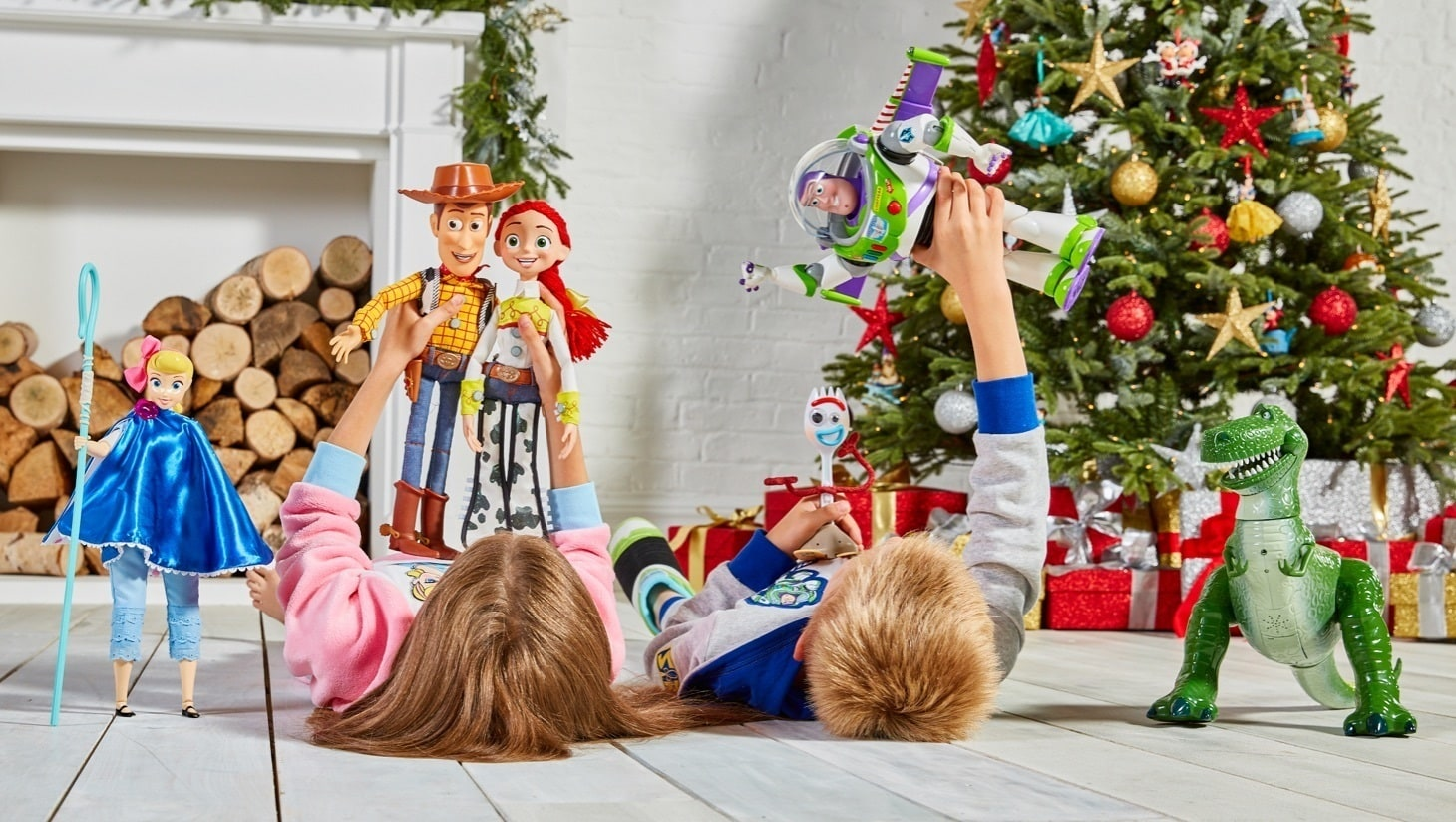 Children playing with Toy Story inspired Talking Action figures