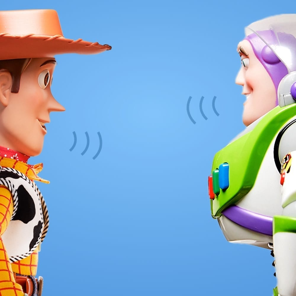 Woody and Buzz from Toy Story with speech marks