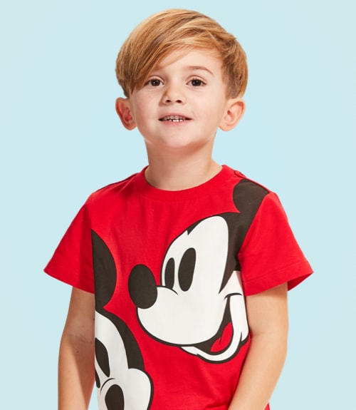 Boy in red t-shirt with Mickey print