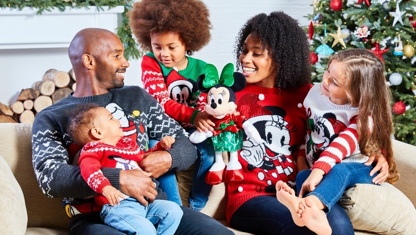 Family wearing Disney inspired christmas jumpers