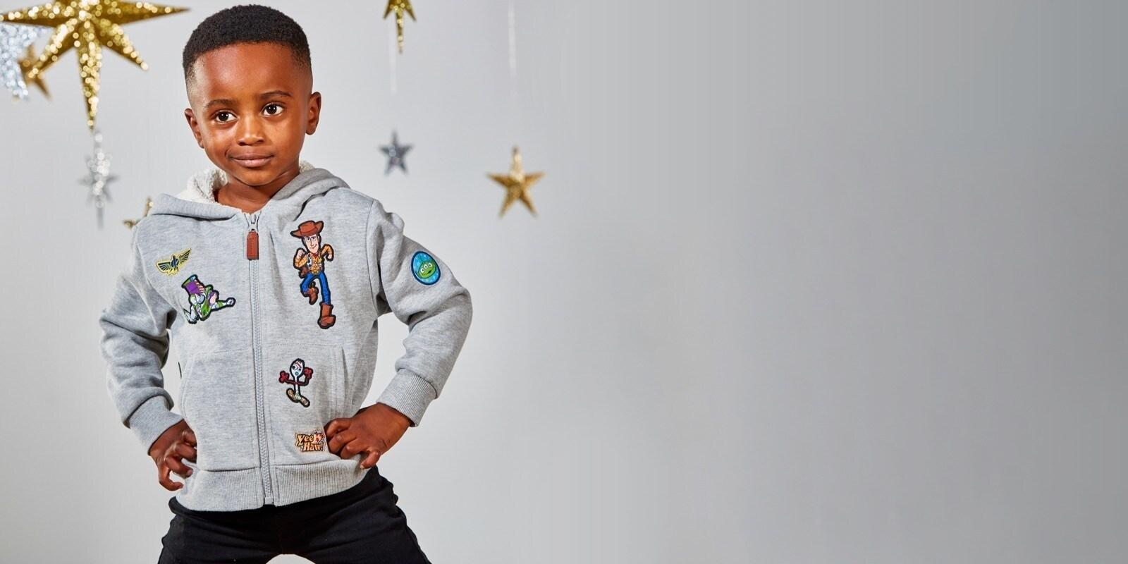 Boy wearing Toy Story inspired hoodie
