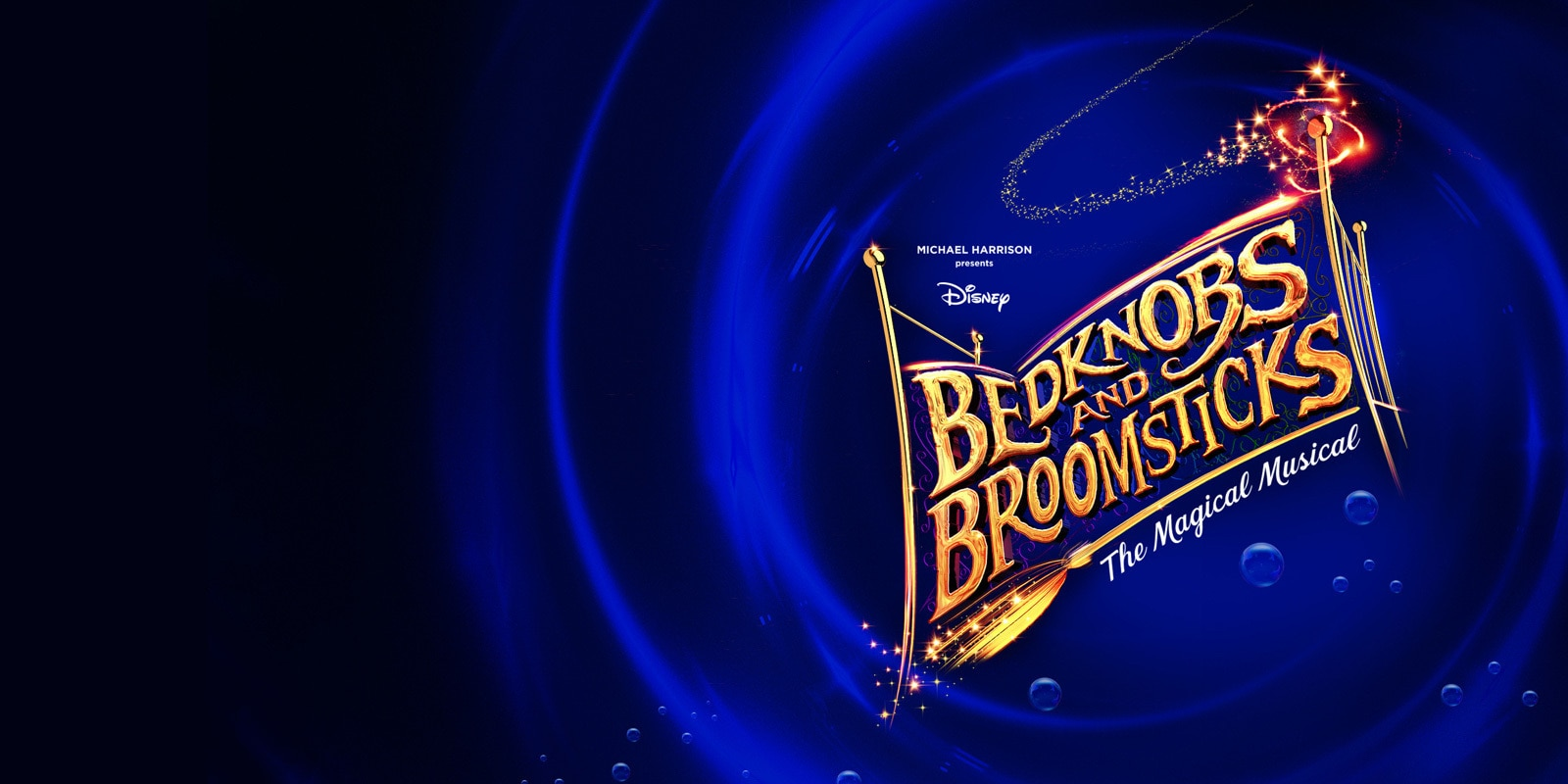 Bedknobs and Broomsticks in the shape of a golden bedframe, on a swirling blue background
