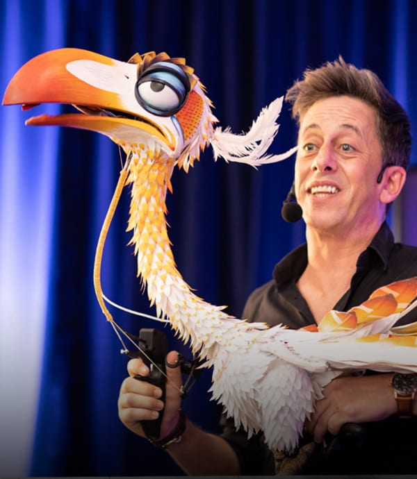 A performer demonstrating the Zazu puppet