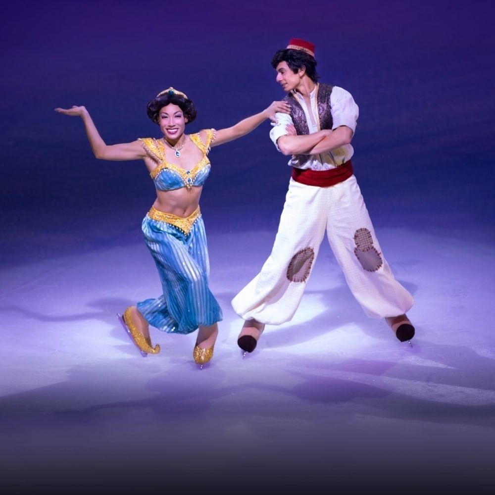 Aladdin and Jasmine dancing next to each other on ice