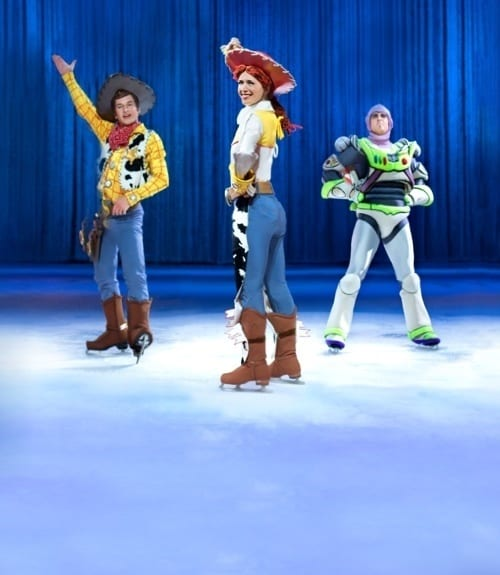 Skaters in costume as jessie, Woody and Buzz