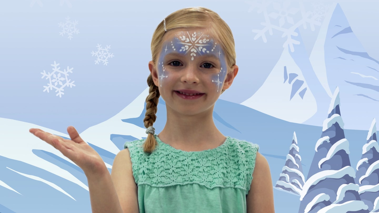 A girl with Elsa themed face paint