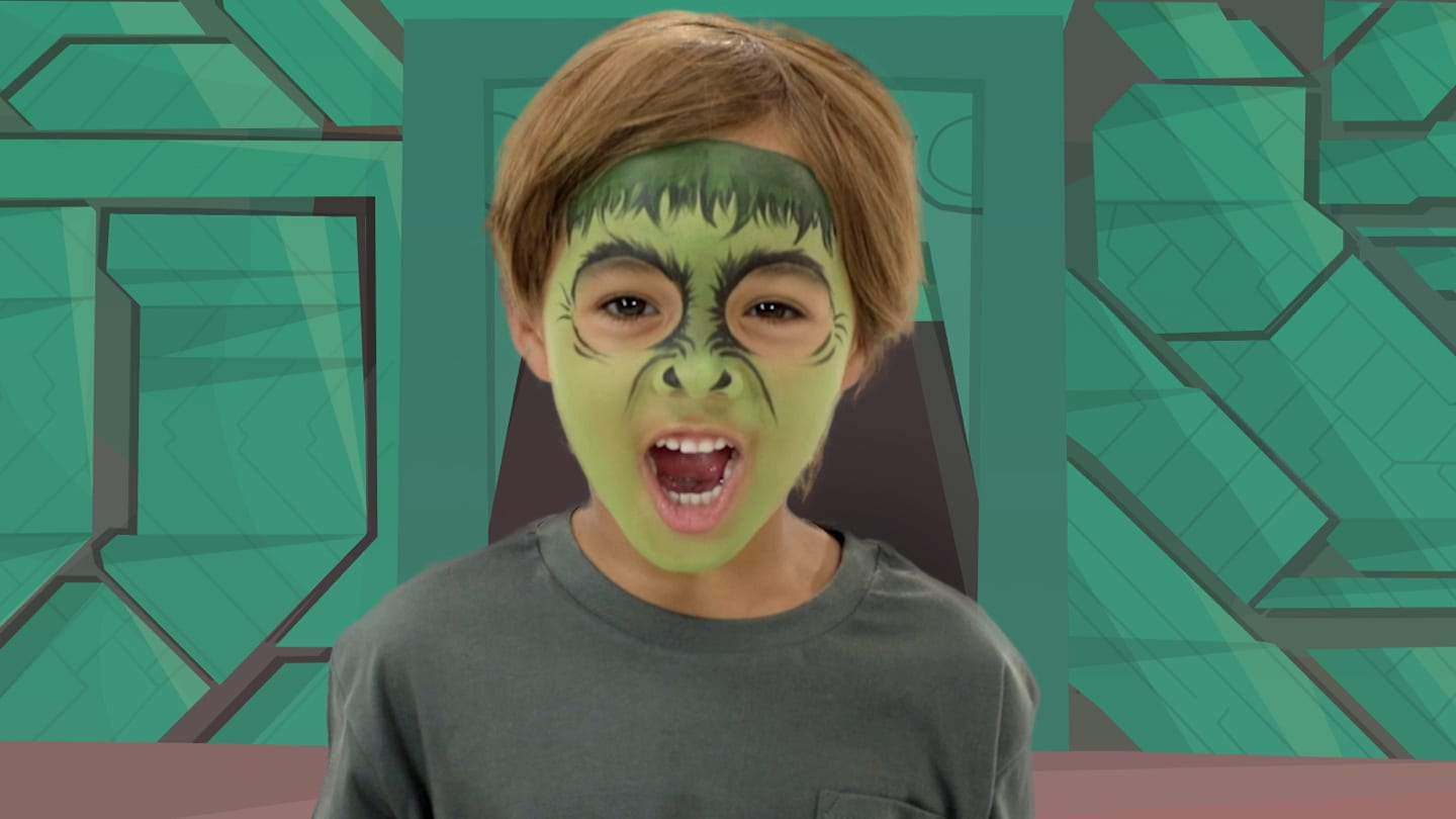 A boy with the Hulk themed face paint