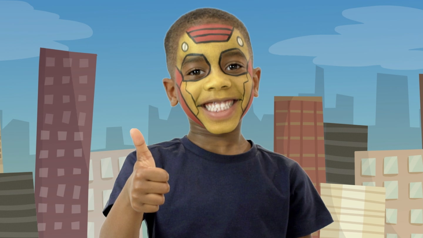 A boy with Iron Man themed face paint