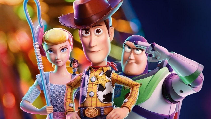 Woody, Buzz and Bo-peep standing in front of a ferris wheel