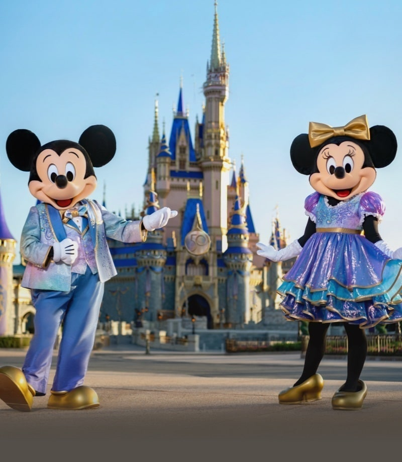 Mickey and Minnie in front of Cinderella's castle at Walt Disney World