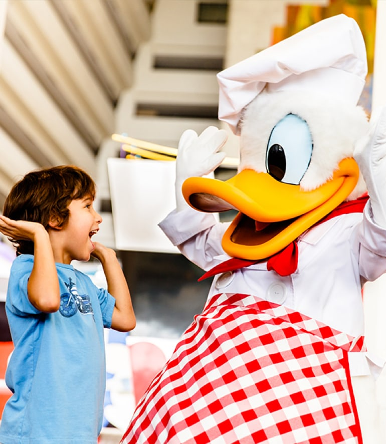 Donald in a chef's outfit with a young boy