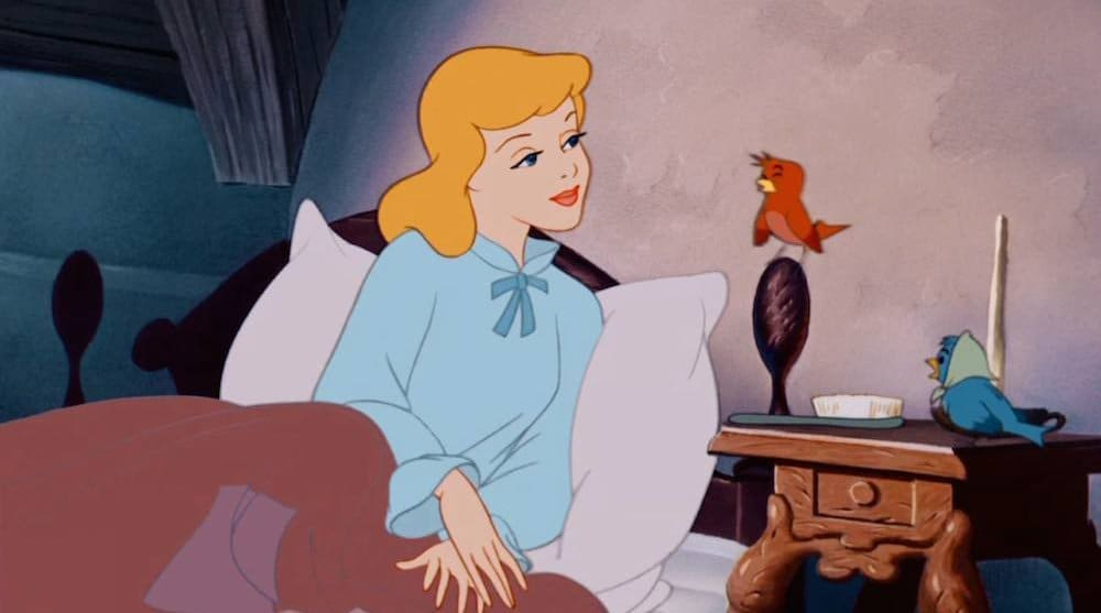 "Cinderella in bed, listening to a red bird, from the animated movie ""Cinderella"""
