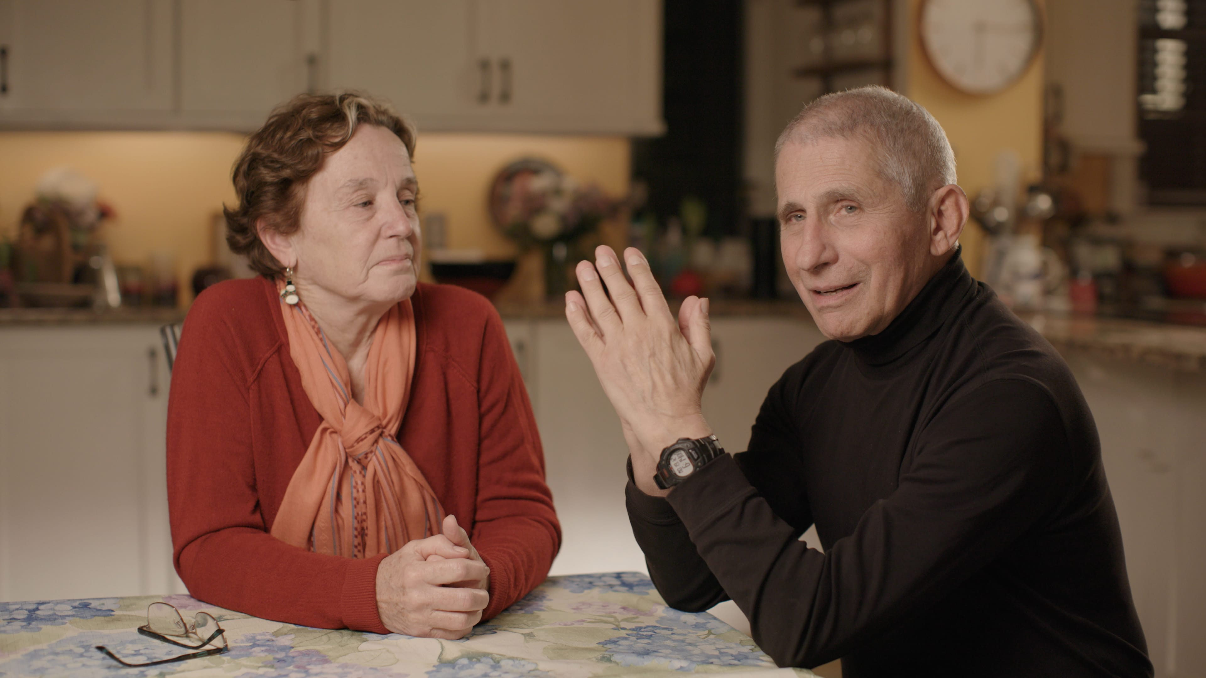 Dr. Anthony Fauci and Christine Grady sit at their kitchen table in December 2020.  (National Geographic for Disney+)