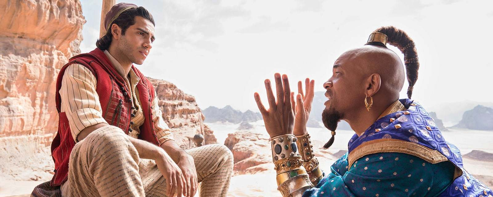 Mena Massoud as Aladdin and Will Smith as Genie in Aladdin