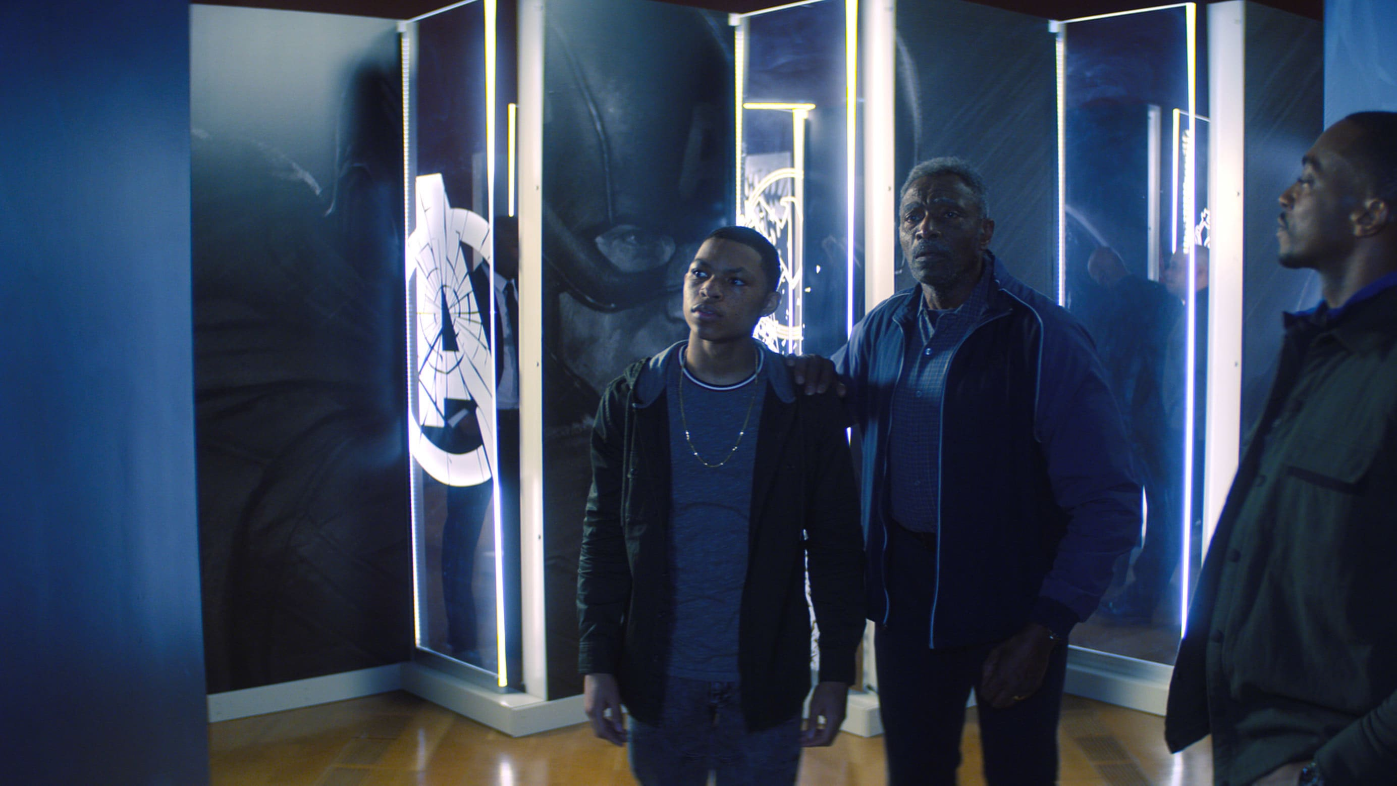 (L-R): Eli Bradley (Elijah Richardson), Isaiah Bradley (Carl Lumbly) and Falcon/Sam Wilson (Anthony Mackie) in Marvel Studios' THE FALCON AND THE WINTER SOLDIER exclusively on Disney+. Photo courtesy of Marvel Studios. ©Marvel Studios 2021. All Rights Reserved.